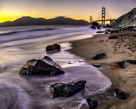 GOLDEN GATE BRIDGE MARSHALLS BEACH ROCKS SAND AND TIDE