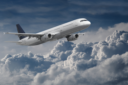 travel industry: Plane flying above the clouds
