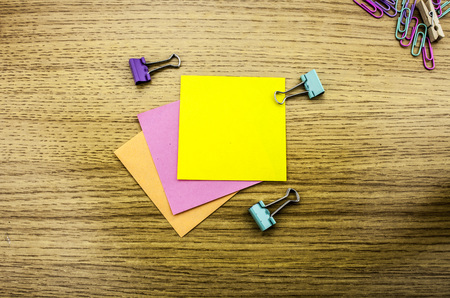 Paper sticker note on wooden background. Blank forms for workers notes.