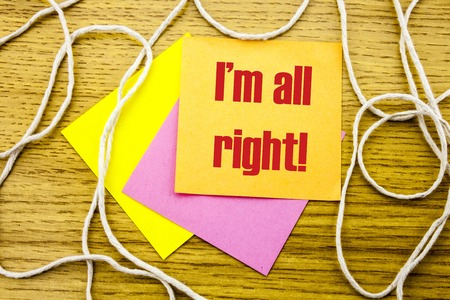 I am all right word on yellow sticky note in wooden background. Bussines concept. Motivational. Imagens