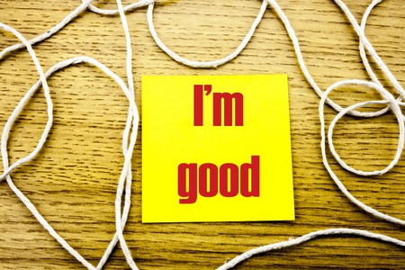 I am good word on yellow sticky note in wooden background. Bussines concept. Motivational.