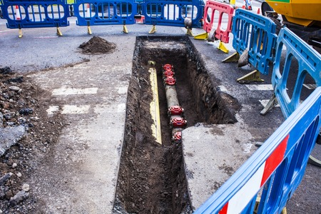 Installing new pipes in city street, maintenance work, dig, reparation, new water pipe.