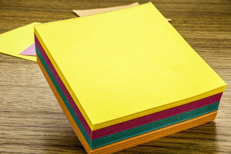 Paper sticker note on wooden background. Blank forms for workers notes.3D illustration