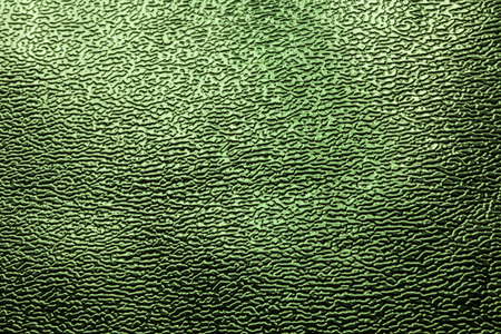 Green shiny background, texture, close up. Metal. Фото со стока