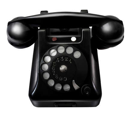 Old retro black telephone on white background
