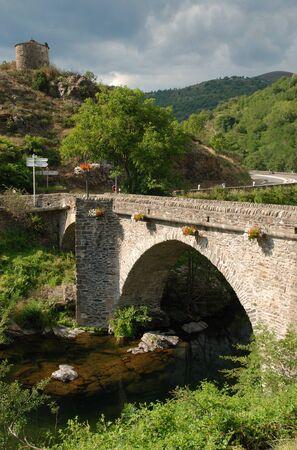 Old stone bridge and torso of windmill photo
