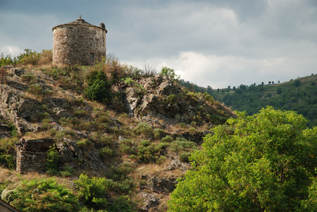 Ancient wildmill on top of hillock photo
