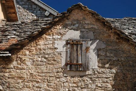 hause: Old window in gable of stone hause