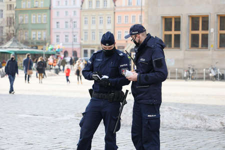 Prevention policeman while IDing a person in the city.