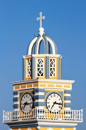 fira: Church clock tower in Fira,Santorini Stock Photo