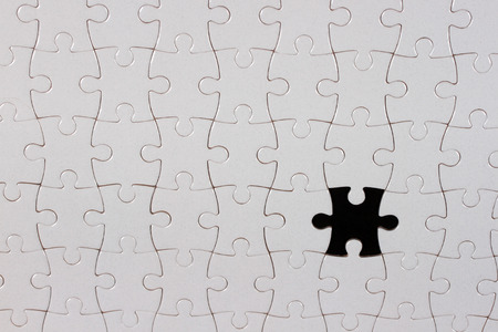 missing piece: Puzzle piece on black background,the missing piece