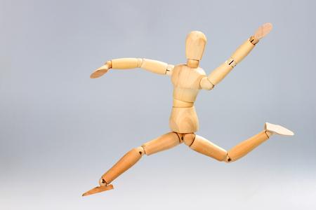 artists mannequin: Wooden mannequin jumping