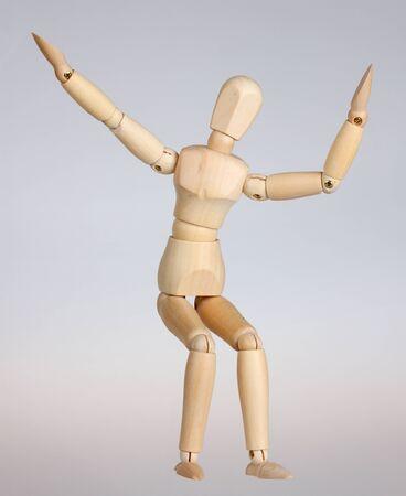 artists dummy: Wooden mannequin happy Stock Photo