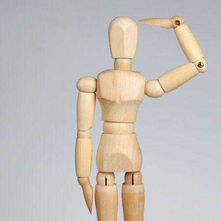 saluting: Wooden mannequin saluting