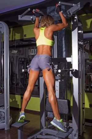 pullups: Fitness girl doing pull-ups Stock Photo