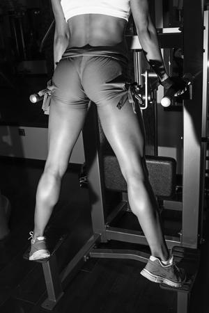 doing: Fitness girl doing pull-ups Stock Photo