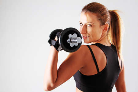 lose weight: Girl training with weights