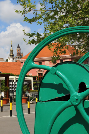 decorative item: Old part of Zemun,Serbia with old water  pump,a decorative item in the city walkway Stock Photo