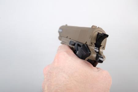 Hand holding modern air gun pistol