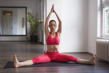 Girl practicing yoga indoors