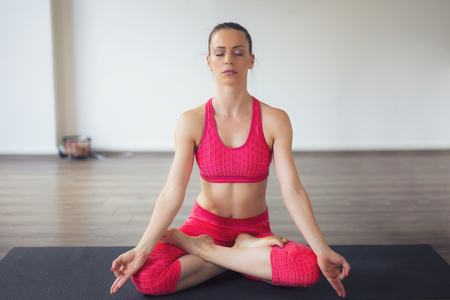 Girl in Lotus Position Practicing Yoga