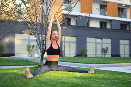 Girl Practicing Yoga Outdoors 스톡 콘텐츠