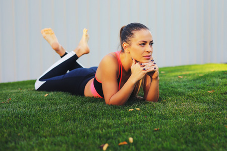 Girl relaxing after fitness Training Outdoors