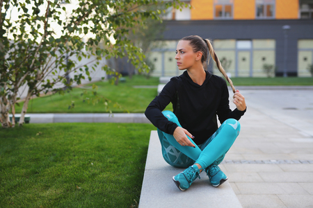 Girl relaxing after fitness training