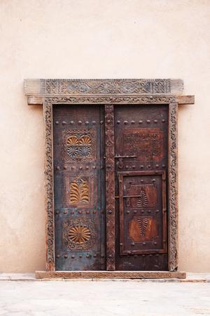 Old wooden decorated door in Oman