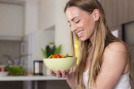 Healthy lifestyle woman eating fresh salad 스톡 콘텐츠