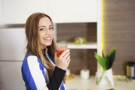Attractive Girl in Sportswear Drinking Tasty Smoothie 스톡 콘텐츠