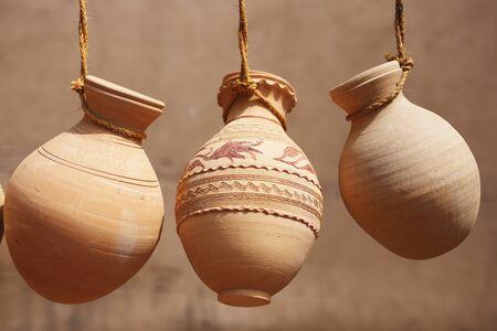 Ceramic jars hanging on ropes on sale in Nizwa market,Oman 스톡 콘텐츠