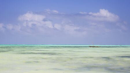 Wooden Fishing Boat in turquoise waters of Indian ocean