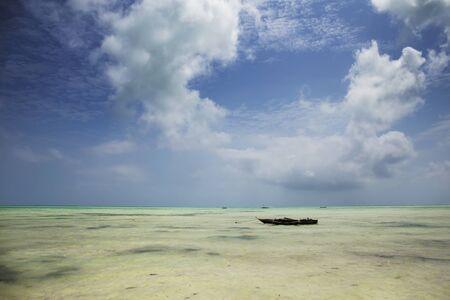Wooden Fishing Boat at Tropical Beach in Zanzibar Island ,Tanzania