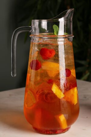 White wine Sangria with various fruits in a pitcher