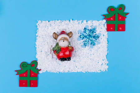 Creative layout,moose in Santa Claus outfit with gifts,Christmas holidays concept