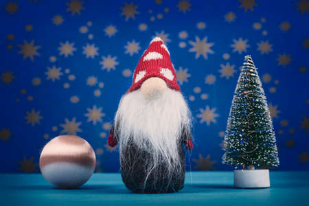 Santa Claus doll with Christmas tree on starry blue background