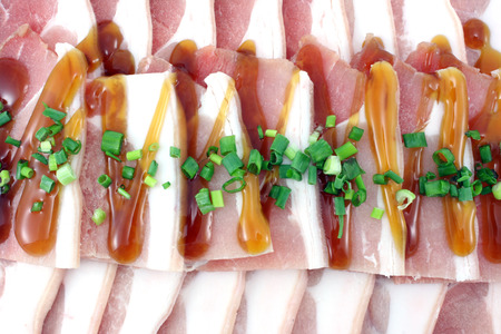 uncooked bacon: Bacon, streaky pork slice on white background Stock Photo