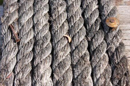 rusty nail: rope and old rusty nail for background Stock Photo