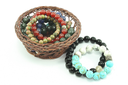 belive: beautiful accessory stone bracelet in basket isolated background