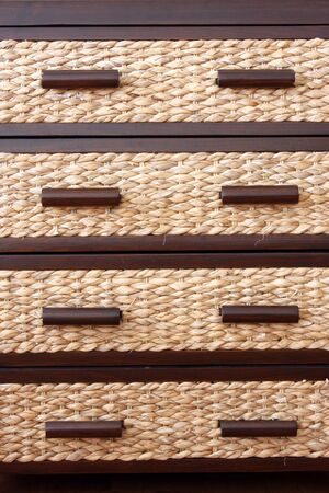 drawers: Rattan drawers in drawer cabinet Stock Photo