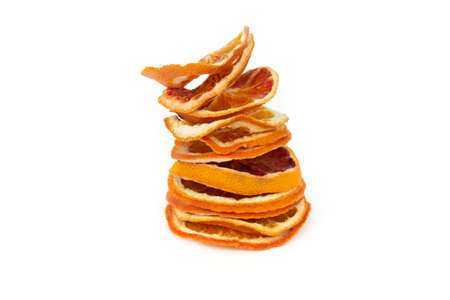 Heap dried orange slices on a white isolated background