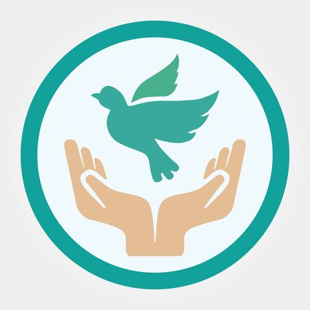 Concept of world without war hands and dove. Symbols for the International Day of Peace