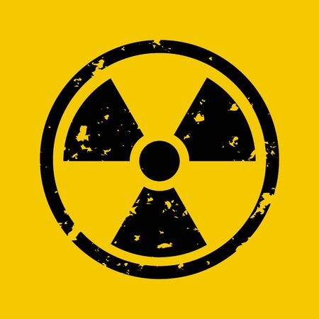 Vector illustration of grunge black radioactive hazard warning sign painted over yellow background.