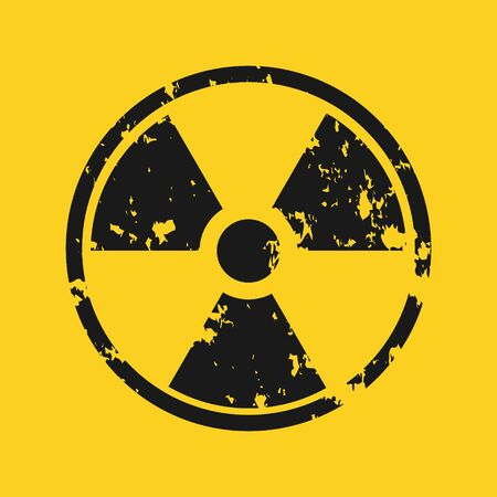 Vector illustration of grunge black radioactive hazard warning sign painted over yellow background