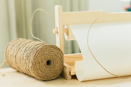 reel with string for gift wrapping on wooden table in a studio 版權商用圖片 - 122686597