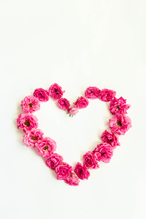 heart of pink roses on white background, nature heart