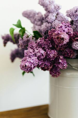 Beautiful purple bouquet of lilac flowers in a stylish vase on a white background 版權商用圖片