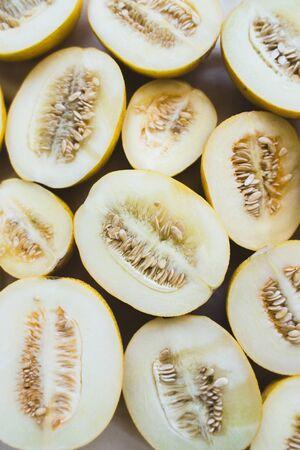 A group of brightly lit melon halves. seasonal summer fruits Reklamní fotografie