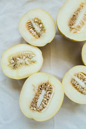 A group of brightly lit melon halves. seasonal summer fruits Stock Photo